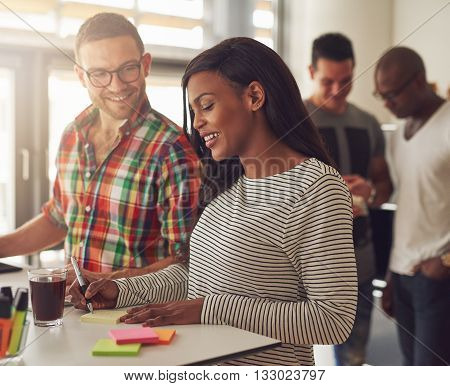 Attractive Male And Female Co-workers At Desk