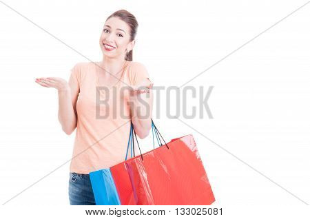 Woman Carrying Shopping Bags Questioning And Raising Shoulders