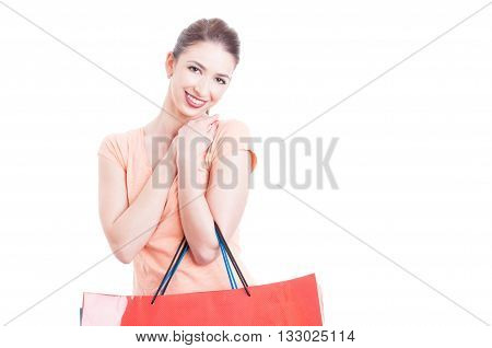 Woman Holding Gift Shopping Bags Smiling And Feeling Pleased