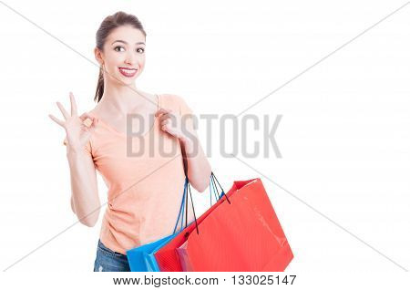 Pretty Lady Holding Shopping Bags Smiling And Showing Okay Gesture