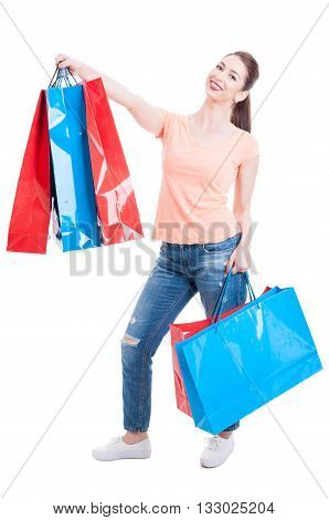 Beautiful Young Woman Standing And Holding Shopping Bags Feeling Satisfied