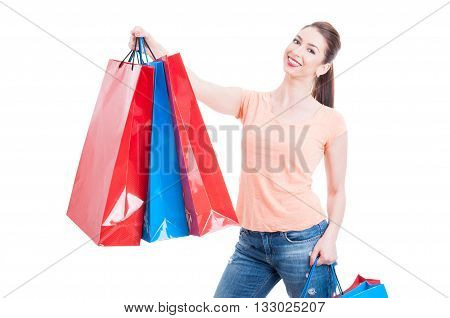 Beautiful Young Woman Holding Few Shopping Bags And Smiling