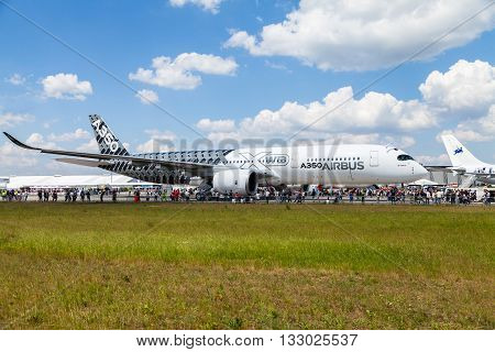 BERLIN / GERMANY - JUNE 3 2016: Airbus A 350 - 900 XWB plane during the ILA in Berlin / Germany on June 3 2016.
