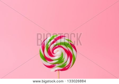 Candy lollipops colorful red, green, pink and white circular background.