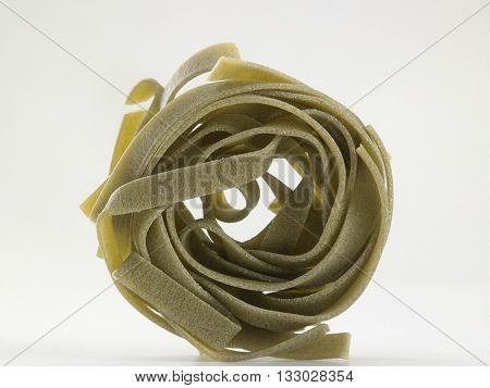 dry fettuccine on the white background