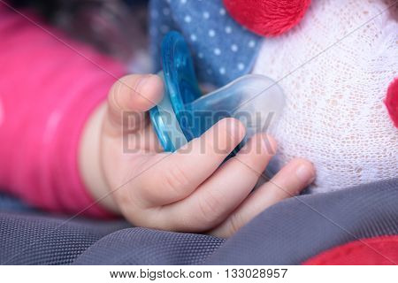 Child Hand With Silicone Pacifier