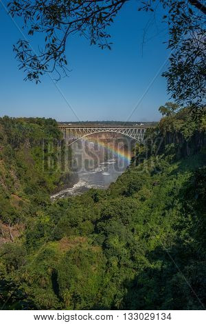 Rainbow Spanning Canyon Beneath Victoria Falls Bridge