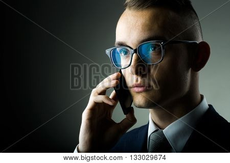 Guy In Glasses With Mobile Phone