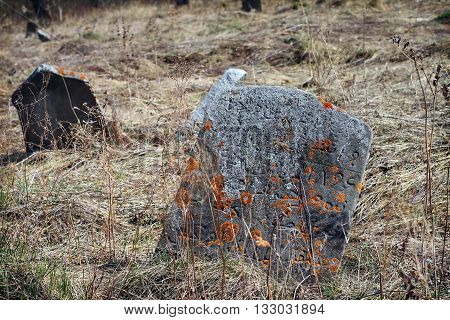 Tombstone with Arabic inscriptions. The ancient Muslim cemetery abandoned found in the woods. Russia