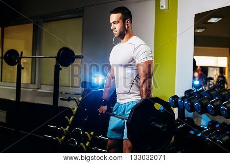 Handsome Fitness Man Weightlifting In Gym