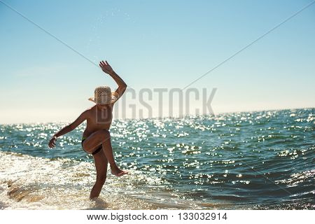 beach boy dancing having fun backlight littered horizon stylized