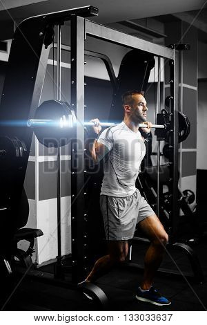 Handsome Fitness Man Weightlifting Workout In Gym