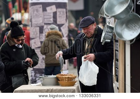VILNIUS LITHUANIA - MARCH 6: Unidentified people trade fresh fish in annual traditional crafts fair - Kaziuko fair on Mar 6 2016 in Vilnius Lithuania