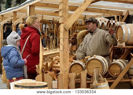 VILNIUS, LITHUANIA - MARCH 4: Unidentified people sell handmade souvenirs from carved wood in annual traditional crafts fair - Kaziuko fair on March 4, 2016 in Vilnius, Lithuania
