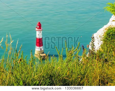 White chalk cliffs and Beachy Head Lighthouse. Eastbourne, East Sussex, England. Selective focus