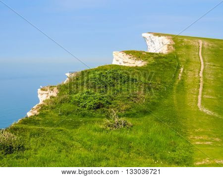 Forces of the English Channel destroy white chalk cliffs. The road on a white chalk cliffs near Eastbourne. East Sussex, England