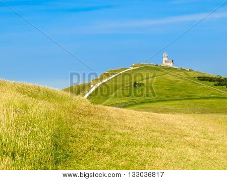 Chalk cliffs and Belle Tout lighthouse. Eastbourne, East Sussex, England