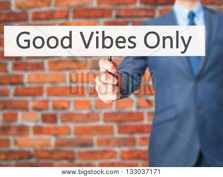 Good Vibes Only - Businessman Hand Holding Sign