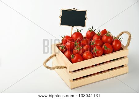 Red Tomatoes With Price Sign Over White