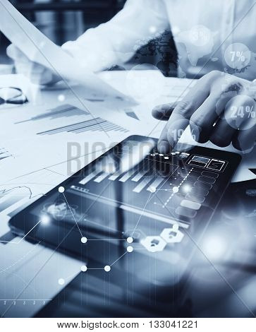 Risk Management Work process.Picture Trader working Market Report Document Touching Screen Tablet.Using Worldwide Graphic Icons, Stock Exchange Reports.Business Project Startup.Vertical, black white