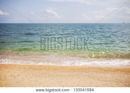 deserted sandy seashore. Sea sunny summer landscape