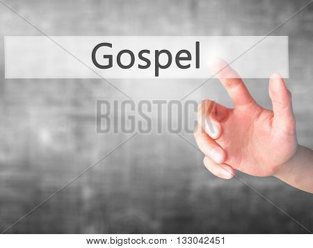 Gospel - Hand Pressing A Button On Blurred Background Concept On Visual Screen.