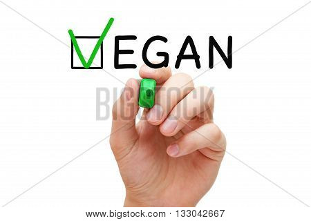 Hand putting check mark with green marker on the tick box in Vegan survey form. Veganism concept.