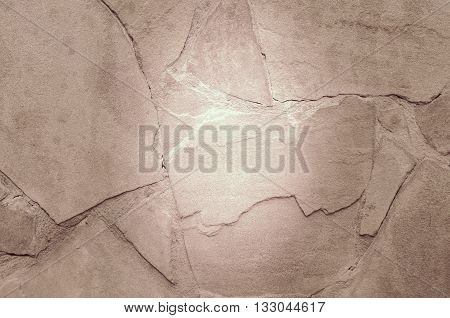 Piece of stone with cracks. Abstract background.