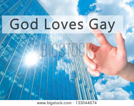 God Loves Gay - Hand Pressing A Button On Blurred Background Concept On Visual Screen.