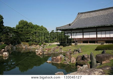 Tranditional Japanese Garden and Wooden House with landscaping