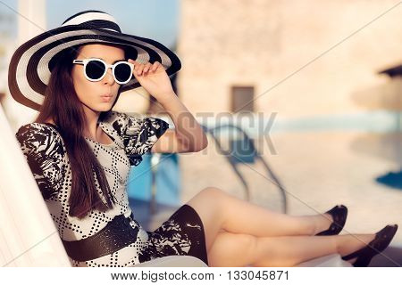 Surprised  Girl With Sunglasses and Hat  Sitting on Sun Chair Checking out fir Paparazzi