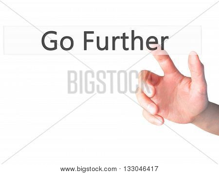 Go Further - Hand Pressing A Button On Blurred Background Concept On Visual Screen.