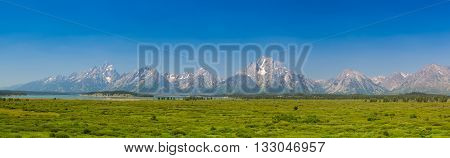 Panorama landscape - The amazing Teton mountains above Jackson Lake in Wyoming USA.