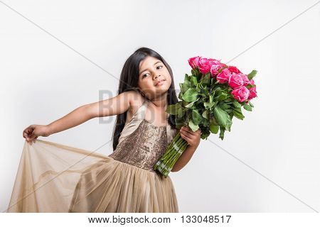 indian little girl holding bouquet or red rose flowers, asian girl with flowers, little indian girl with bunch of red roses