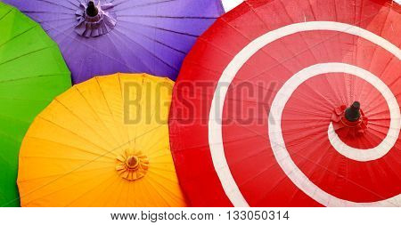 The Traditional Asian paper umbrellas isolated on white color backgrond