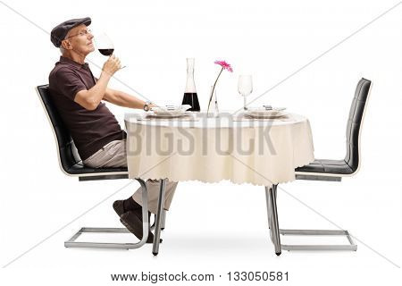 Studio shot of an elderly wine taster smelling a glass of red wine isolated on white background