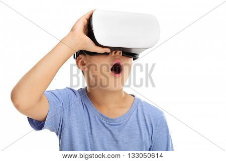 Amazed little boy experiencing virtual reality isolated on white background
