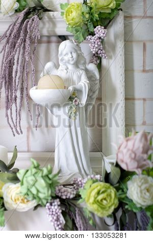 Figure of an angel with flowers and candles