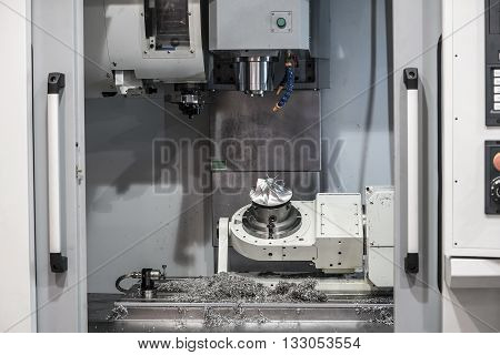 CNC machine close up. Industrial background. Metal processing machine, heavy industry