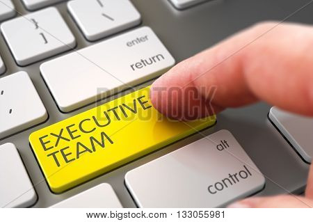 Hand Finger Press Executive Team Key. Close Up view of Male Hand Touching Executive Team Computer Key. Hand Pushing Executive Team Yellow Modern Laptop Keyboard Key. 3D Illustration.