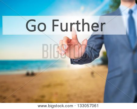Go Further - Businessman Hand Pressing Button On Touch Screen Interface.