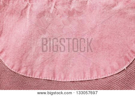 Blank pink clothes label as a background