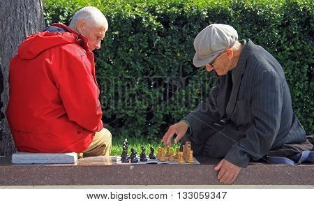 Men Are Playing Chess Outdoor In Yekaterinburg, Russia