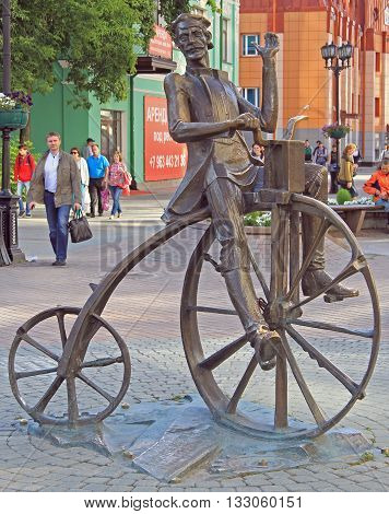 Yekaterinburg Russia - July 20 2015: The bronze sculpture of the inventor of the bike Artamonov set on the street Weiner in Yekaterinburg
