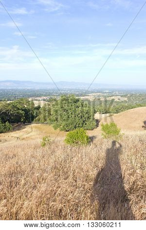 Shadow of a photographer taking pictures at Rancho Santo Antonio Los Altos California USA