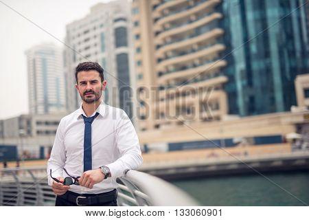 Handsome elegant businessman enjoying a business trip.