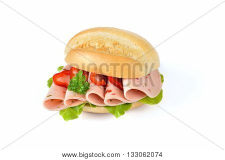 Fresh bun with sliced sweet pepper sausage and a lettuce leaf on white background