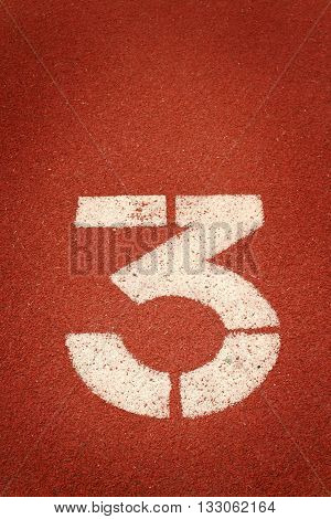 The number 3 on a running track
