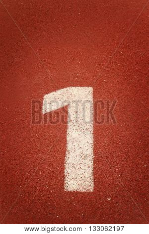 The number 1 on a running track