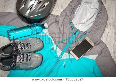 Sport stuff on wooden floor top view